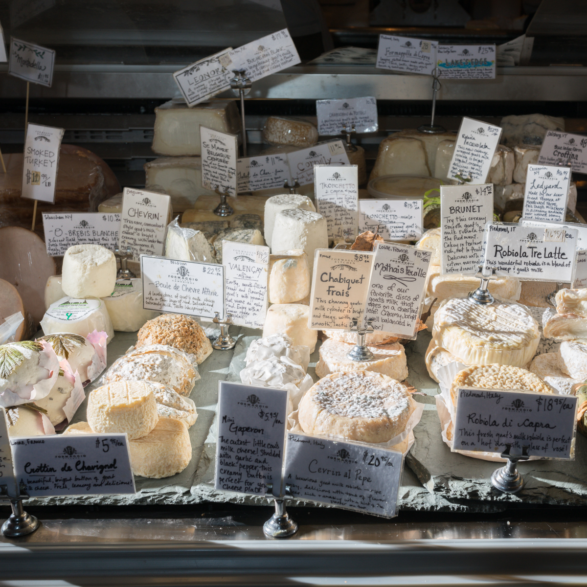 The cheese case at Formaggio Kitchen's flagship location in Huron Village