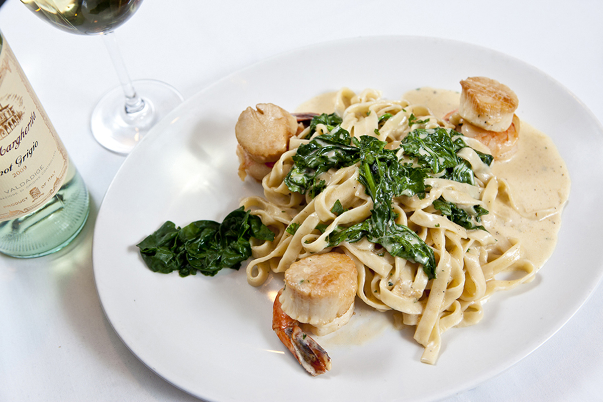 """The Original"" fettuccine Strega, with shrimp, scallops, spinach, and a creamy sauce."