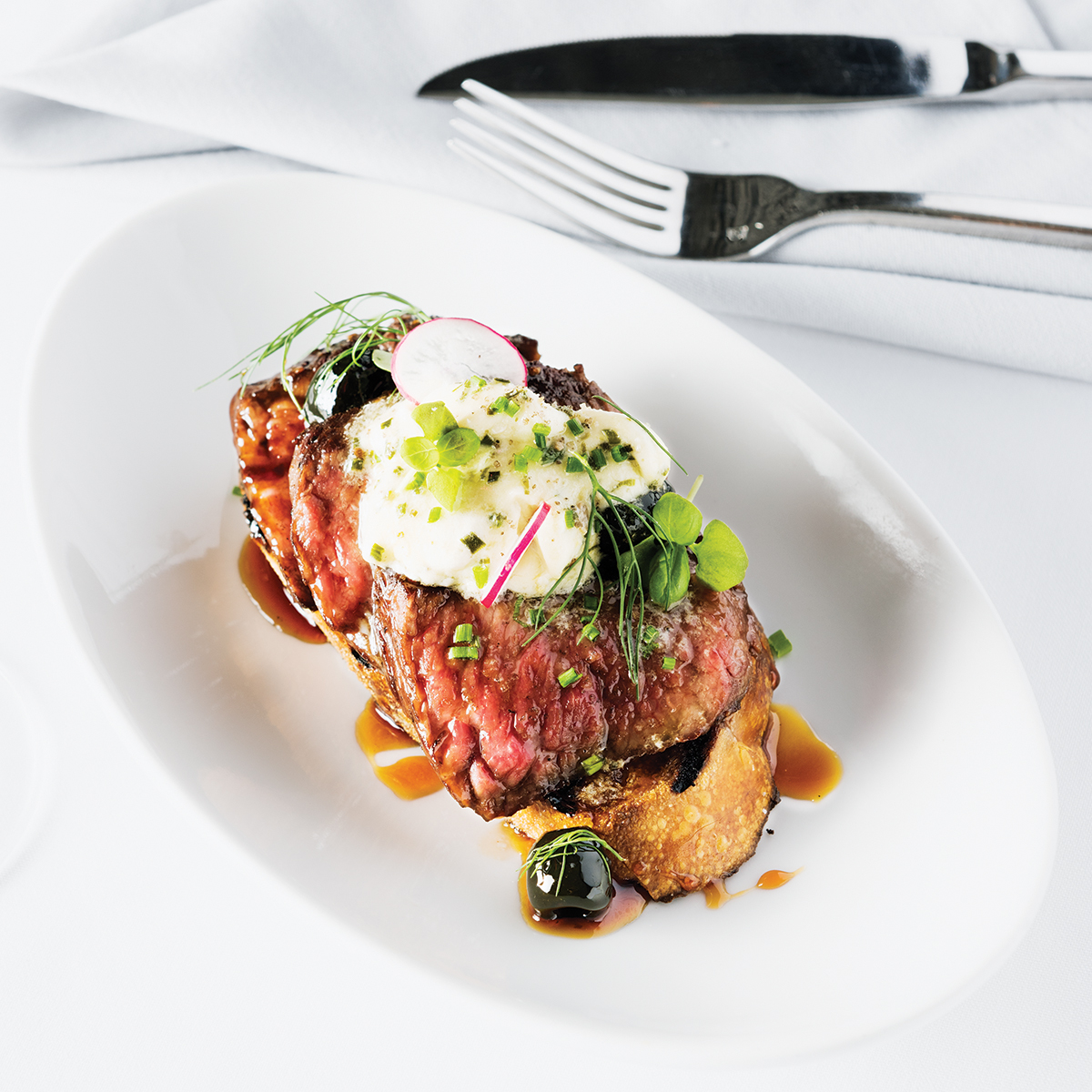 """Bavette steak """"Mirabeau"""" with anchovy butter and caramelized olives at Yvonne's in Boston"""