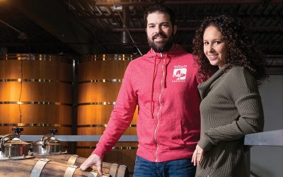 Trillium's JC and Esther Tetreault in the barreling mezzanine of the Canton brewery