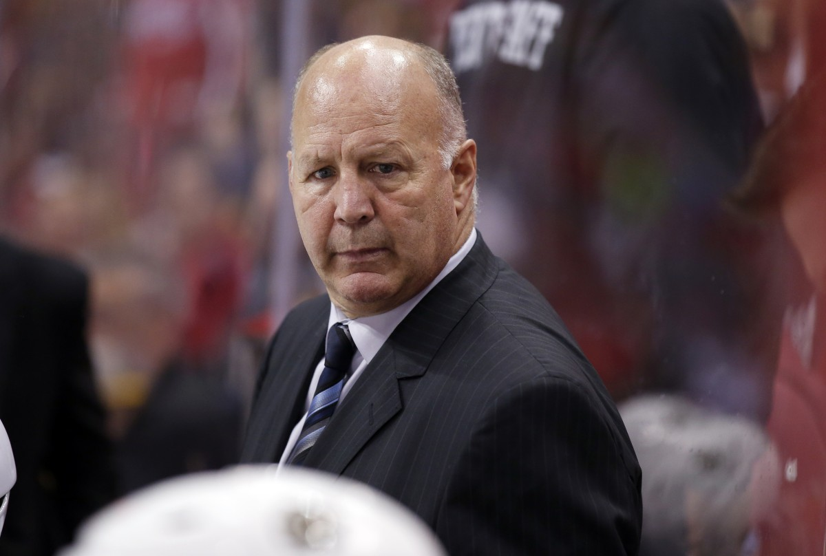 Boston Bruins head coach Claude Julien stands in the bench in the third period of an NHL hockey game against the Washington Capitals, Thursday, Nov. 5, 2015, in Washington. The Capitals won 4-1. (AP Photo/Alex Brandon)