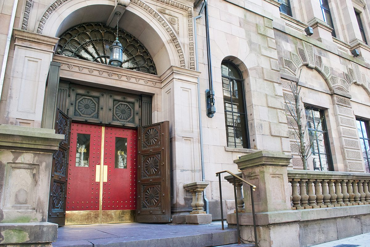 The red leather doors to the Boston Athenaeum welcome members and  visitors.Photo by Madeline Bilis