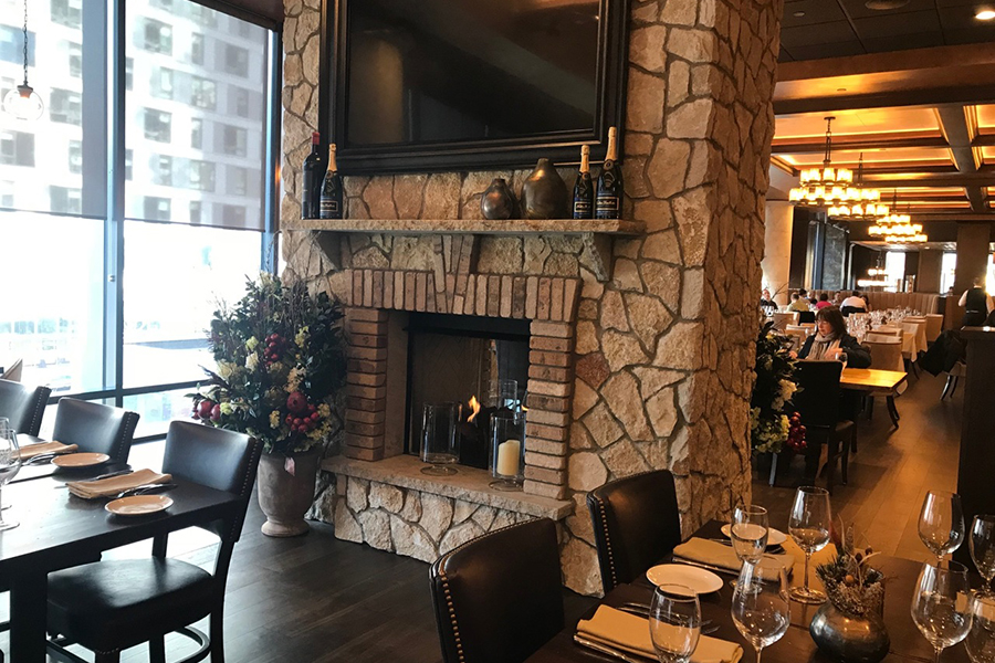 The dual-sided fireplace at the new Seaport Tuscan Kitchen