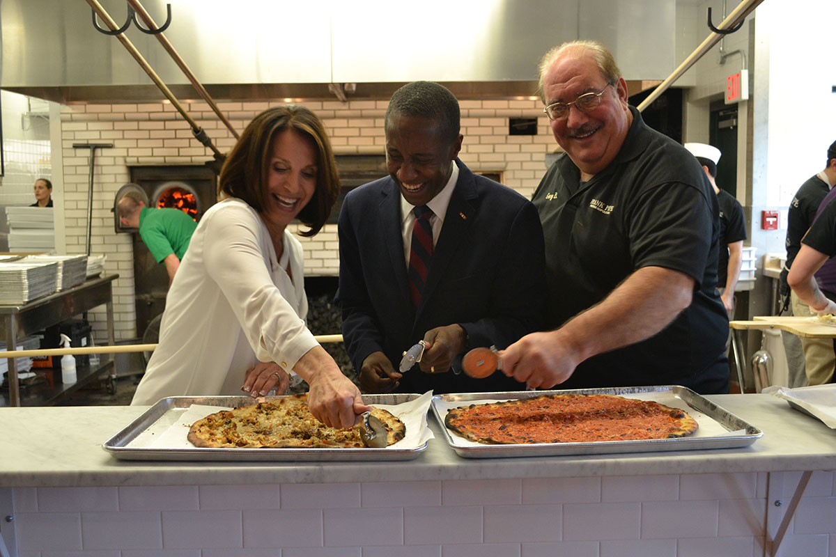 (L to R) Frank Pepe's co-owner Jennifer Kelly, Newton Mayor Setti Warren,and Gary Bimonte at Chestnut Hill's grand opening in December 2015