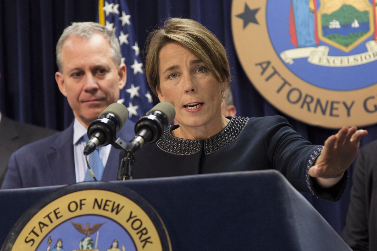 """Massachusetts Attorney General Maura Healey, right, joined by New York AG Eric Schneiderman, discusses a lawsuit against Volkswagen, Tuesday, July 19, 2016, in New York. The states are suing Volkswagen and its affiliates Audi and Porsche over diesel emissions cheating, alleging that the German automakers defrauded customers by selling diesel vehicles equipped with software allowing them to cheat emissions testing. In response the company said, """"The allegations in complaints filed by certain states today are essentially not new and we have been addressing them in our discussions with U.S. federal and state authorities."""" (AP Photo/Mark Lennihan)"""