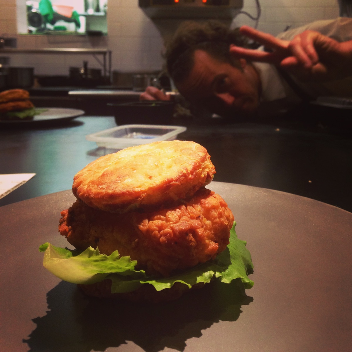 Chef Alex Crabb and fried chicken and a biscuit at Asta