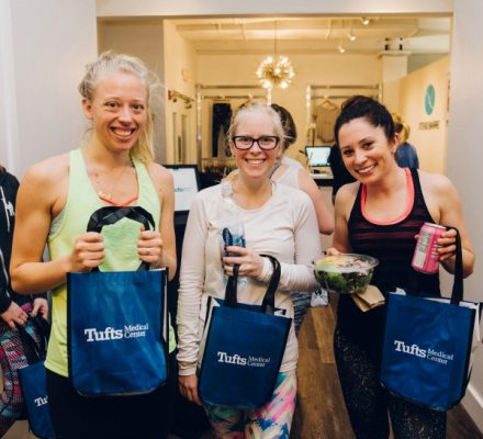 Guests pose with their exciting giveaways from Tufts Medical Center, Sweetgreen, and Polar Beverages / Photo by Kathryn Riley