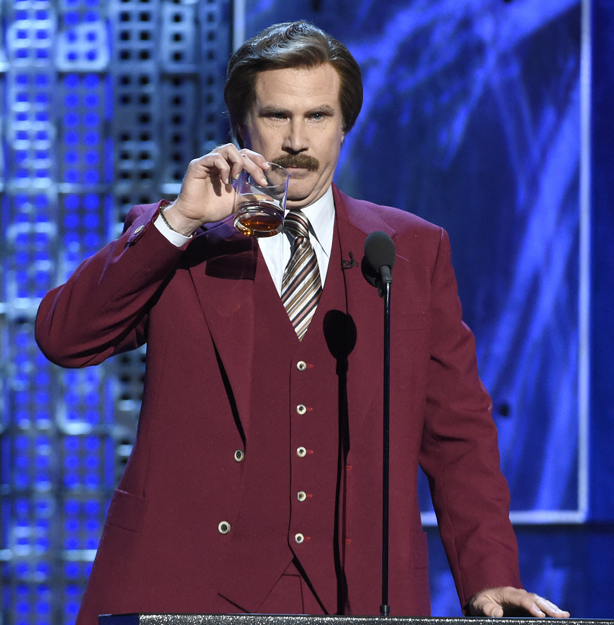 """Will Ferrell appears in character as Ron Burgundy from """"The Anchorman"""" films at the Comedy Central Roast of Justin Bieber at Sony Pictures Studios on Saturday, March 14, 2015, in Culver City, Calif. (Photo by Chris Pizzello/Invision/AP)"""