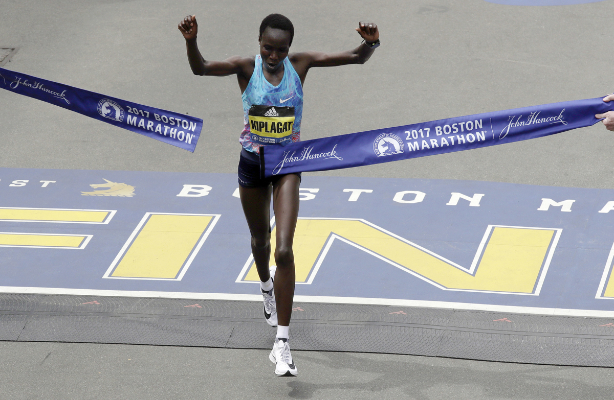 Edna Kiplagat, of Kenya, wins the women's division of the 121st Boston Marathon on Monday, April 17, 2017, in Boston. (AP Photo/Charles Krupa)