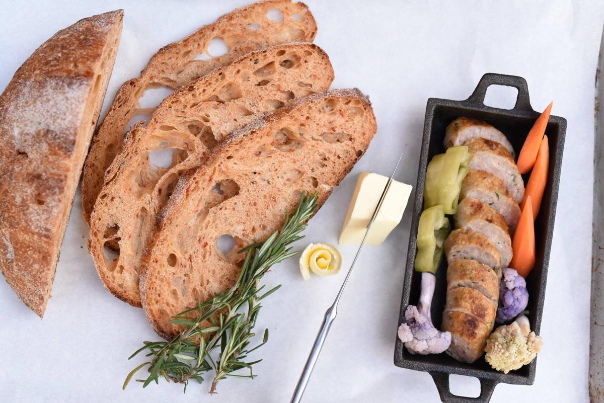 Brato Brewhouse sourdough bread, bratwurst, and pickles