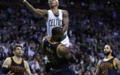 Boston Celtics guard Isaiah Thomas, top, collides with Cleveland Cavaliers forward LeBron James during the fourth quarter of an NBA basketball game in Boston, Wednesday, March 1, 2017. The Celtics defeated the Cavaliers 103-99