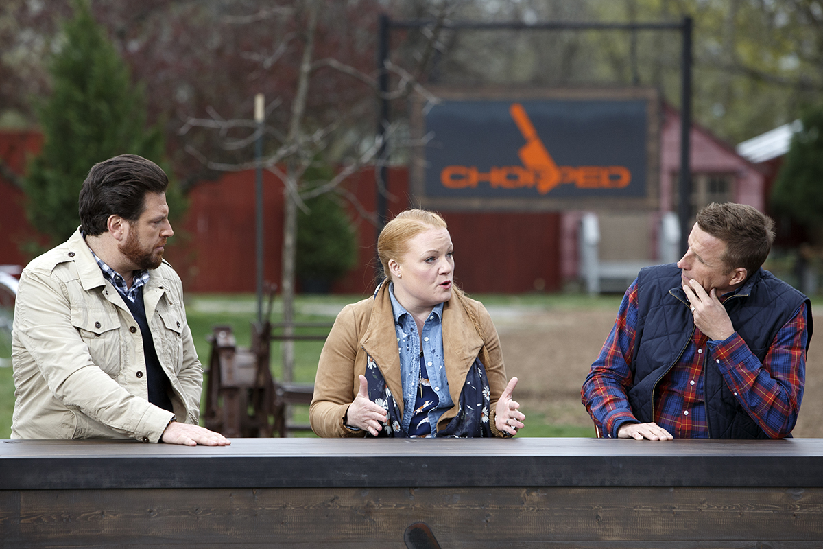 Judges Scott Conant, Tiffani Faison and Marc Murphy deliberate on Chopped Grill Masters