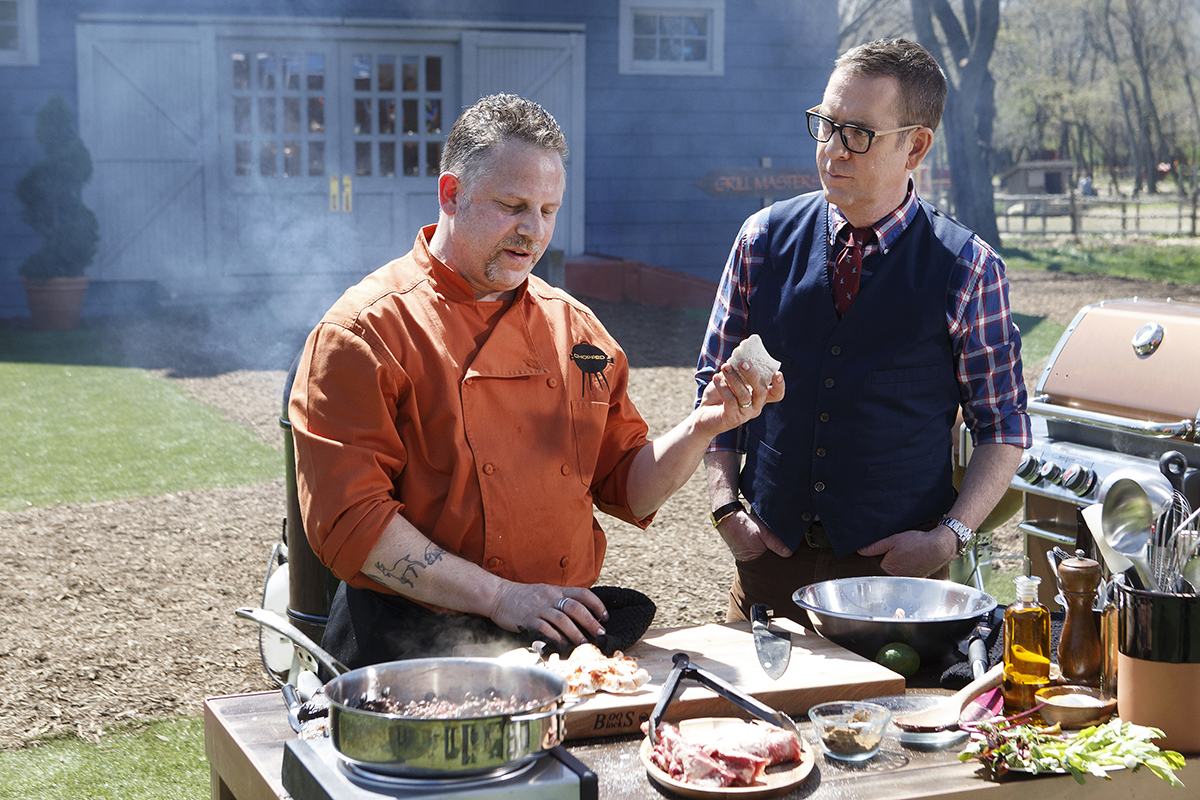 Host Ted Allen and chef Andy Husbands on Chopped Grill Masters
