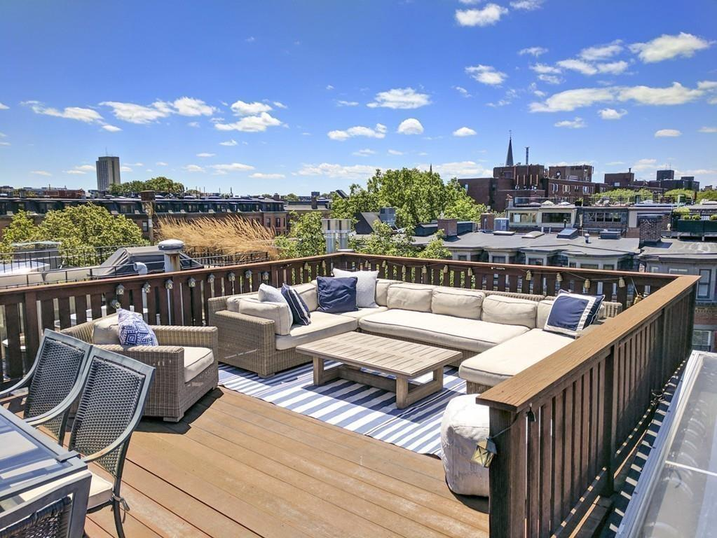 Five condos for sale with amazing roof decks boston magazine for Top deck roofing