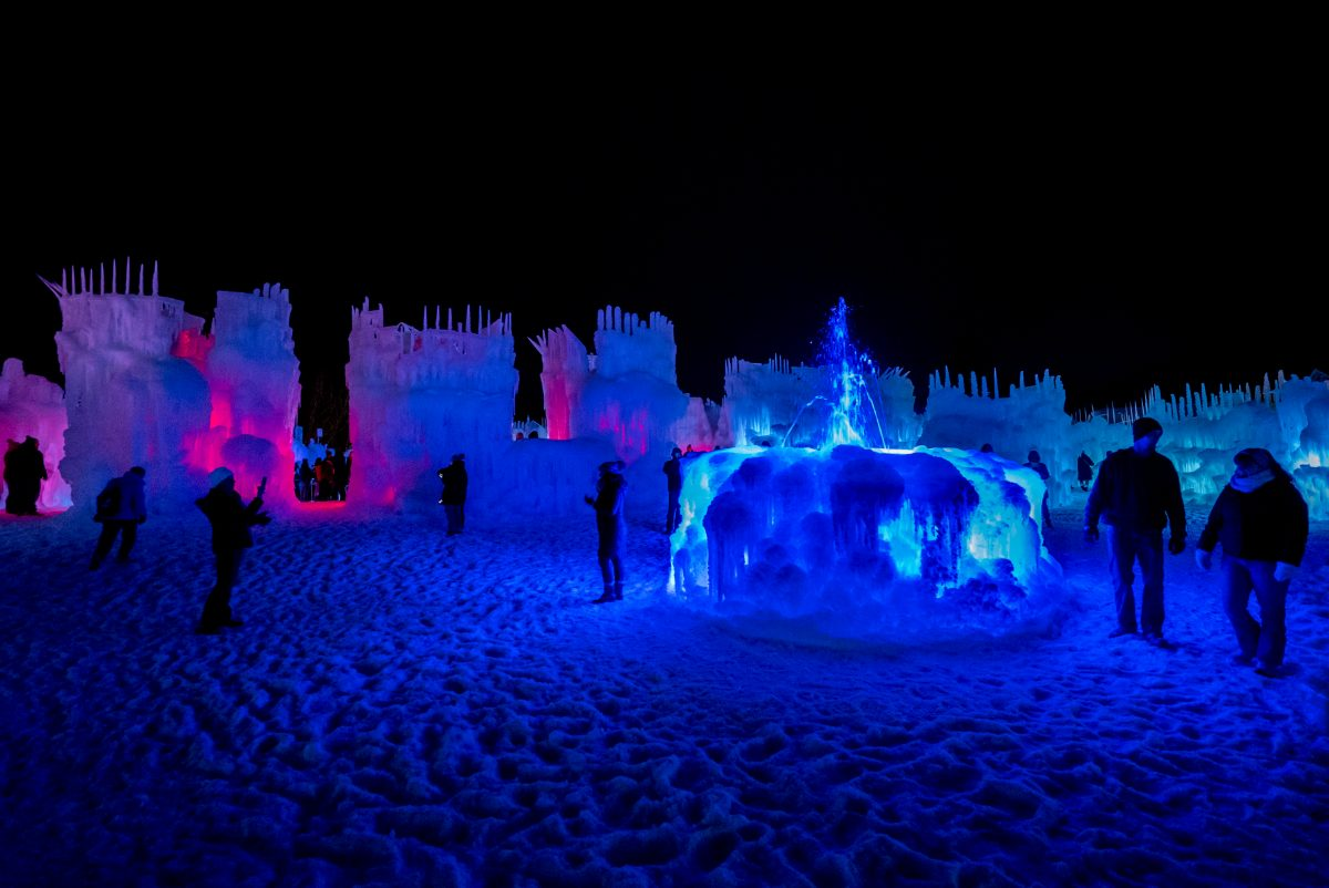 Visitors walk around an LED-lit fountain. / Photo provided