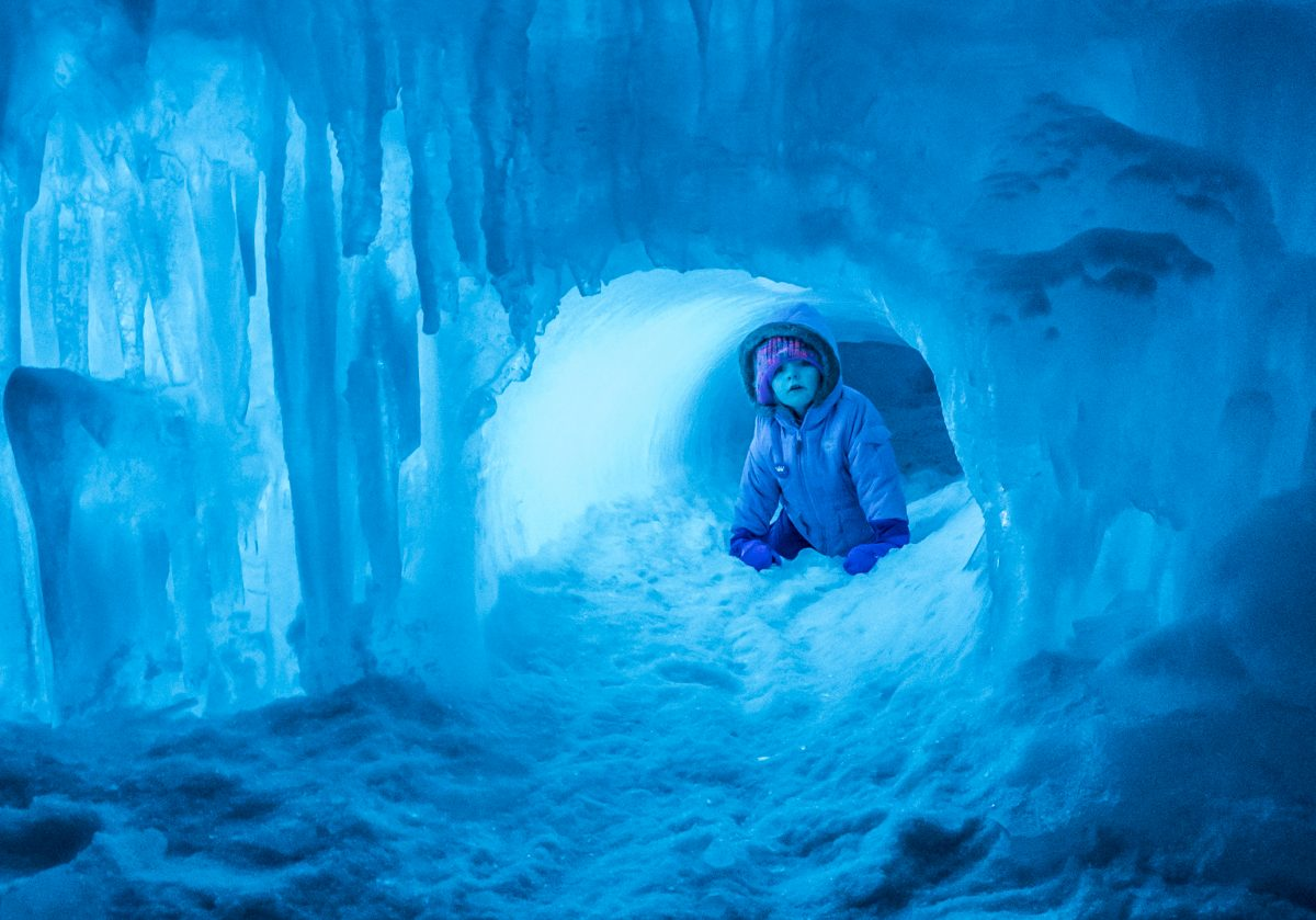A child crawls through a frozen tunnel. / Photo provided