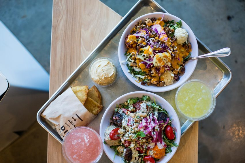 A spread at Cava, a fast-casual Mediterranean concept opening four locations near Boston in 2018