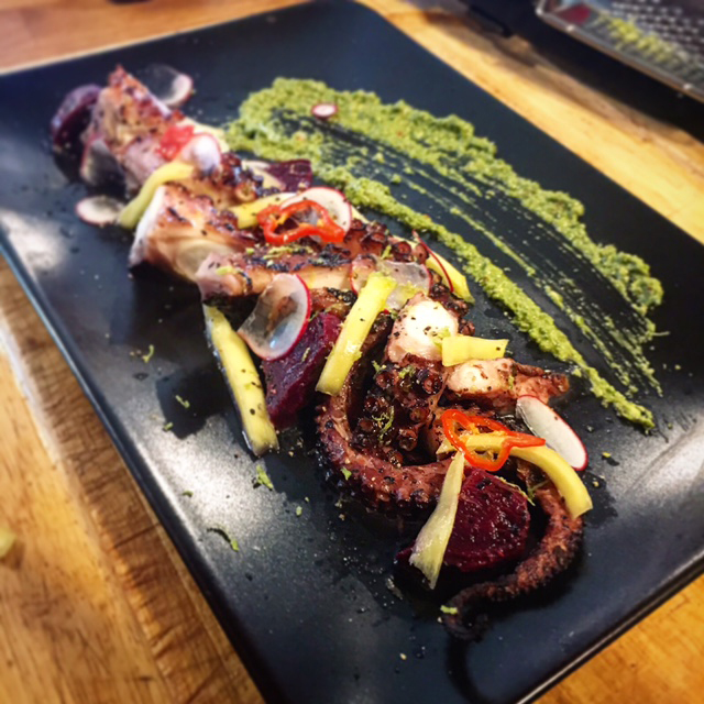 Grilled octopus with spicy pickled mango, habanero, and <em>zhoug</em> from Simcha