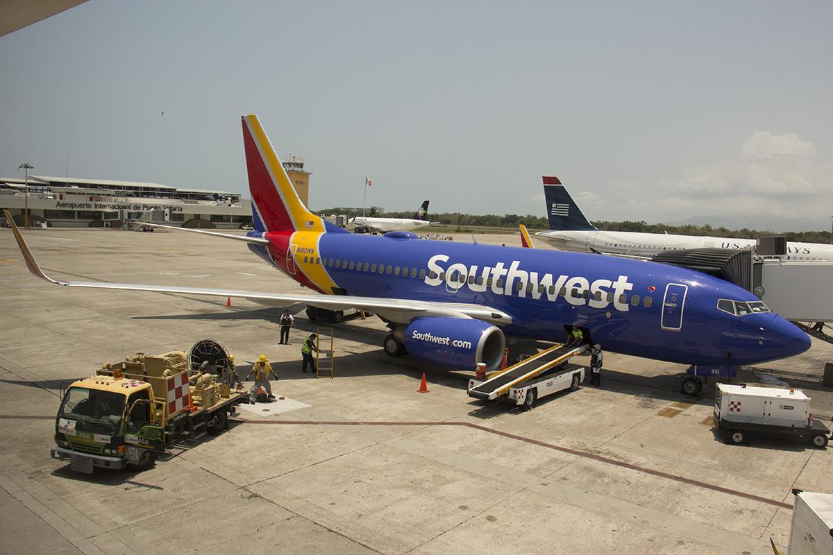 A parked Southwest plane at a gate.