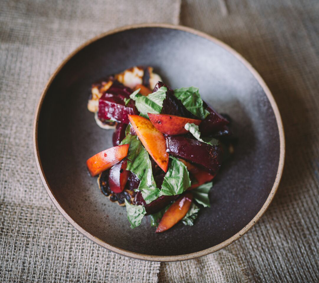 Grilled beets with peach, halloumi, and basil at Field & Vine