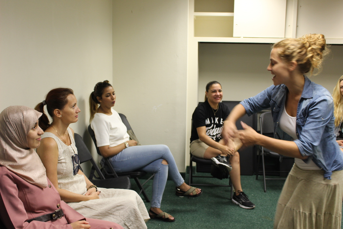 Women talk in a circle at a clinic