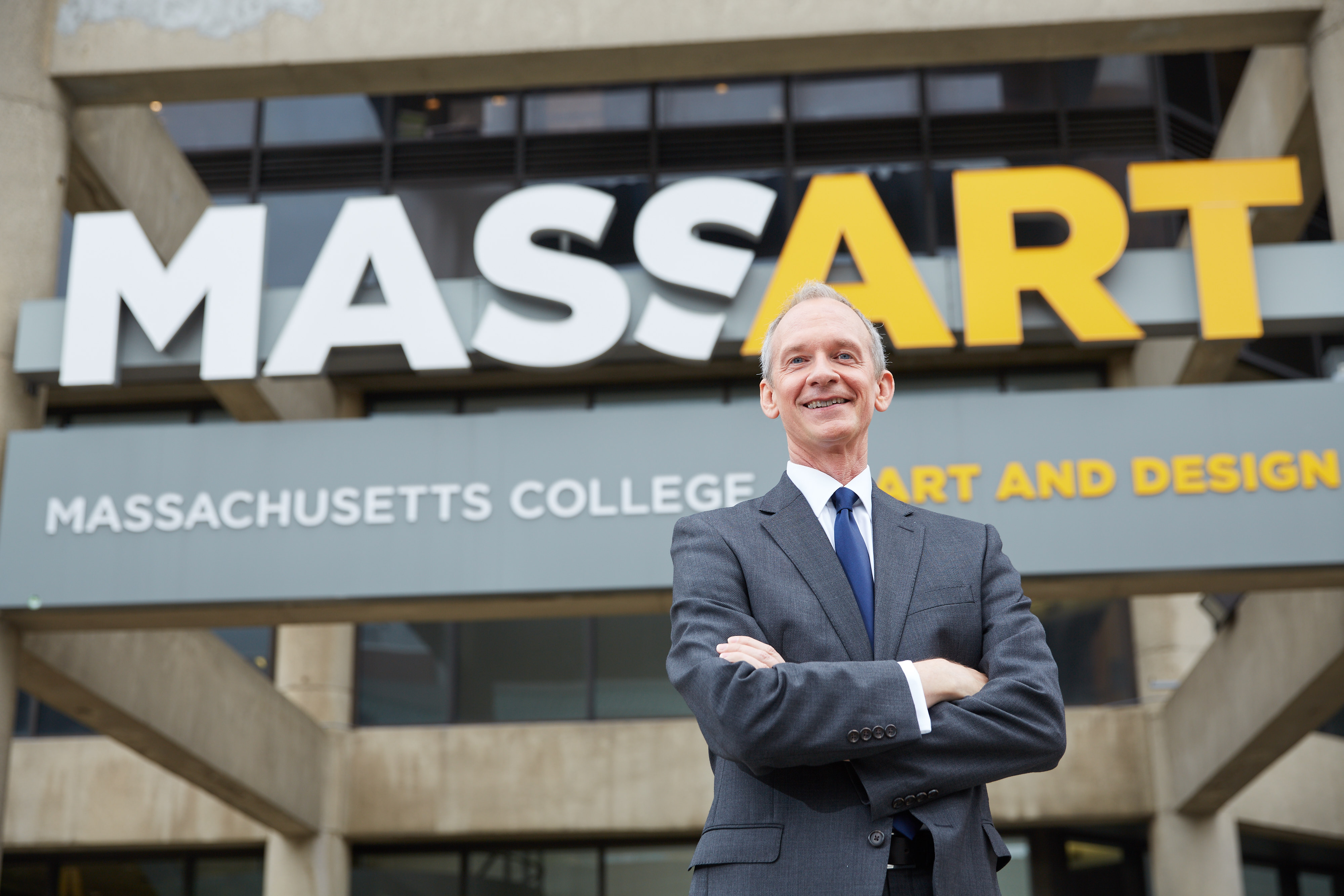 David Nelson in front of the MassArt sign.