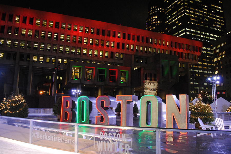 """Boston"" in red and green letters on an ice rink in front of City Hall"