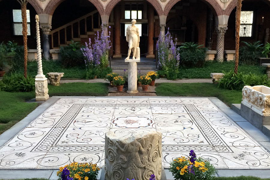 Flowers and green grass decorate the Gardner Museum's courtyard