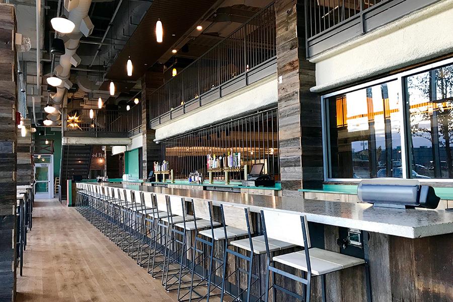 The main bar at Flatbread Company at Boston Landing, Brighton