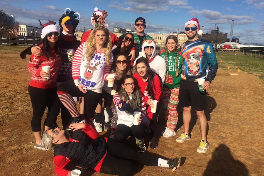 Kickball team members wearing sweaters and holiday gear