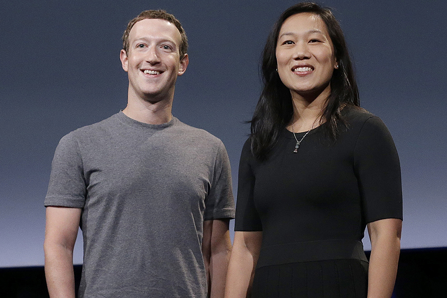 Mark Zuckerberg and Priscilla Chan smiling