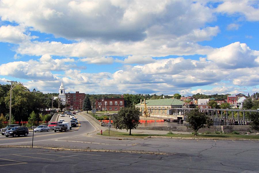 A rural town beneath a blue, cloudy sky