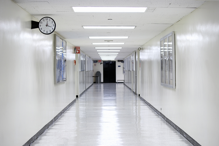 An empty hallway with a clock