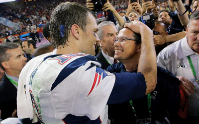 Tom Brady smiles at Alex Guerrero after winning the Super Bowl
