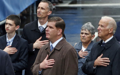From right, U.S. Vice President Joe Biden, Boston Mayor Marty Walsh, and former Boston Mayor Thomas Menino, react along with the family of Boston Marathon bombing victim Martin Richard, behind, during a remembrance ceremony at the finish line on Boylston Street in Boston, Tuesday, April 15, 2014.