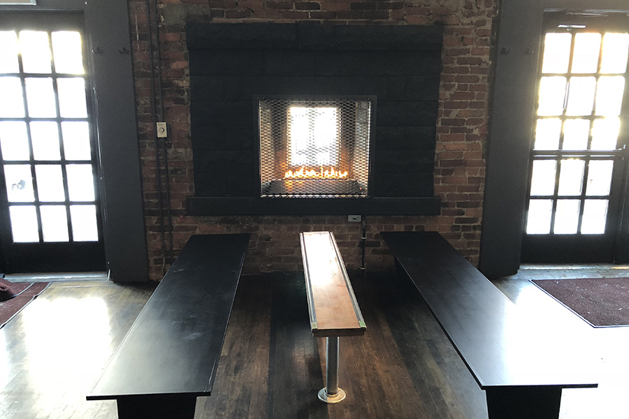 A fireplace warms a lounge area at Trina's Starlite Lounge in Amesbury