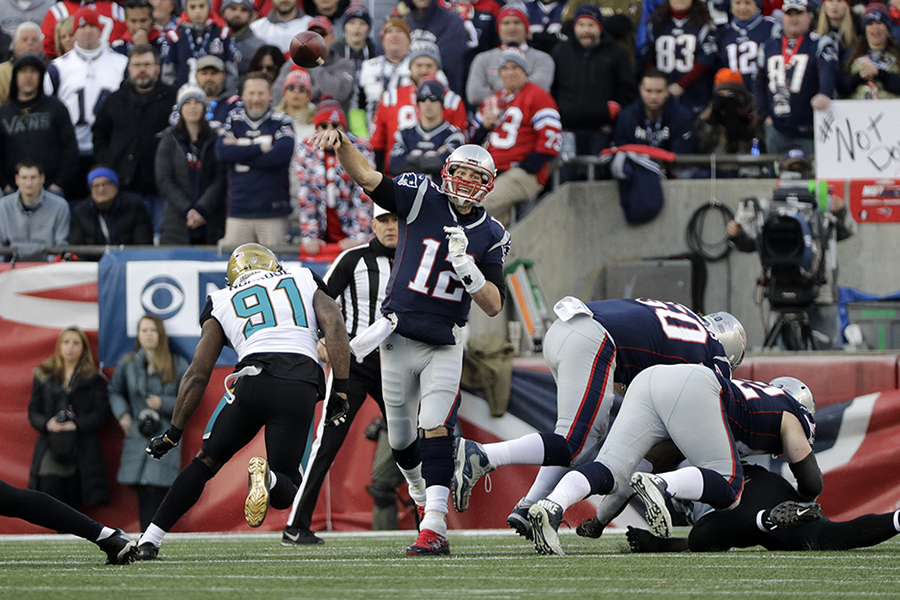 New England Patriots quarterback Tom Brady (12) throws against the Jacksonville Jaguars during the first half of the AFC championship NFL football game, Sunday, Jan. 21, 2018, in Foxborough, Mass.