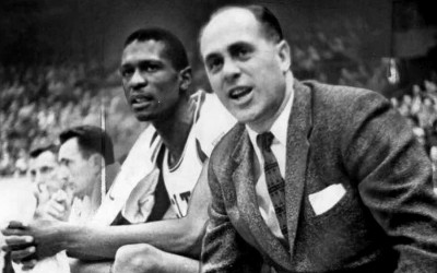 Red Auerbach and Bill Russell sit on the bench