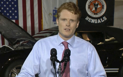 "In this still image taken from video, Rep. Joe Kennedy III delivers the Democratic response to President Donald Trump's State of the Union, at Diman Regional Vocational Technical High School in Fall River, Mass., Tuesday, Jan. 30, 2018. Kennedy, 37, a three-term congressman and grandson of former Attorney General Robert F. Kennedy, outlined a Democratic vision that he said promises a ""better deal for all who call this country home."" ("