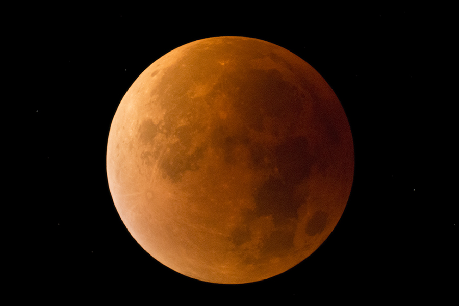 The red, large moon during a total lunar eclipse