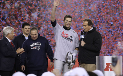 Bill Belichick, Robert Kraft, and Tom Brady receive the Lombardi trophy and are surrounded by confetti