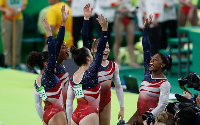 The members of the 2016 U.S. Gymnastics team celebrate in Rio de Janeiro, Brazil