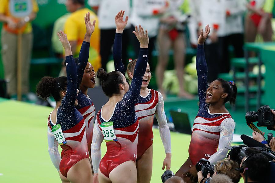 The members of the 2016 U.S. Gymnastics team celebrate in Rio de Janeiro, Brazil