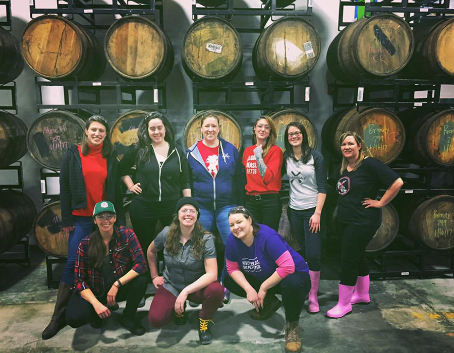 Brienne Allan (top row, 4th from right) during a past Pink Boots Brew Day
