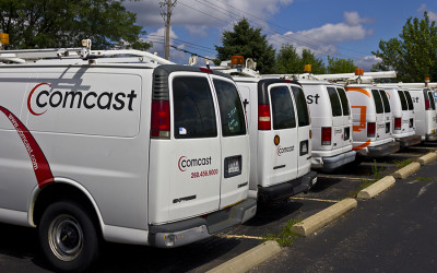 A row of Comcast-branded vans