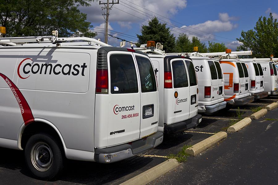 A row of Comcast vans
