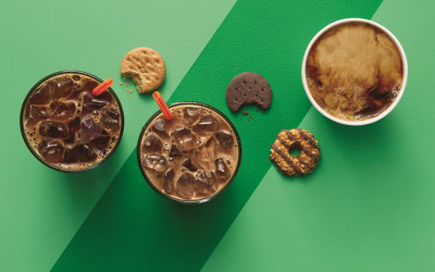 An overhead shot of Girl Scout Cookies and Dunkin' Donuts coffees
