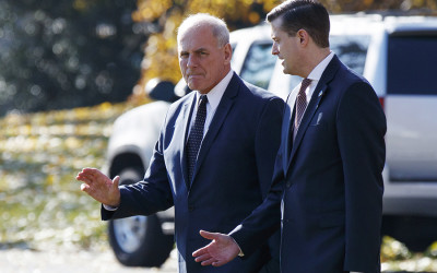 John Kelly and Rob Porter walk together