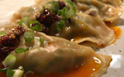 Scallop and linguiça dumplings with piri piri sauce from Puritan Trading Co.