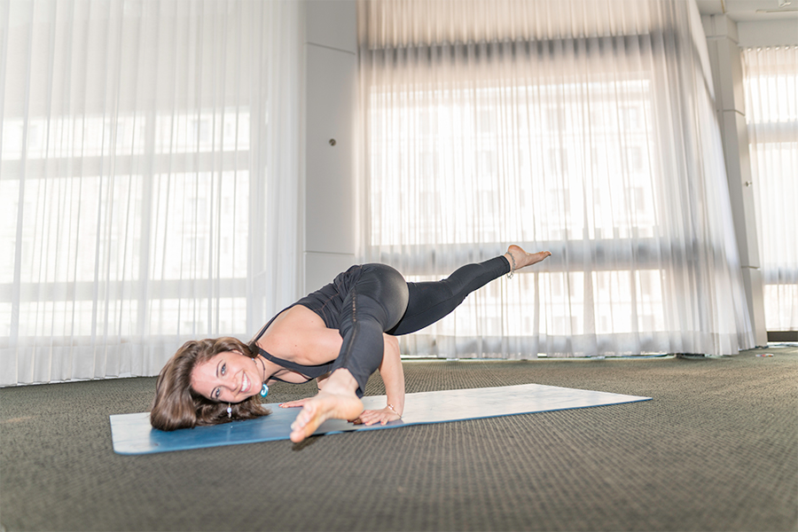 Ali singer, a yoga instructor, in a balancing pose